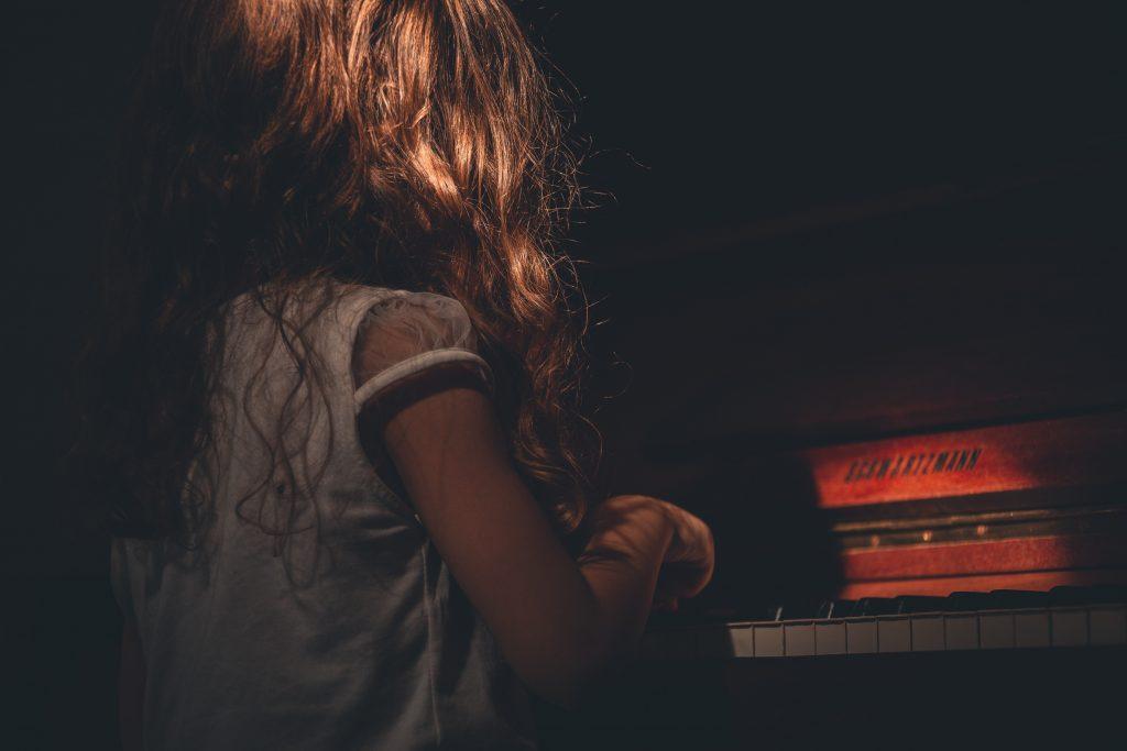 girl sitting in the dark
