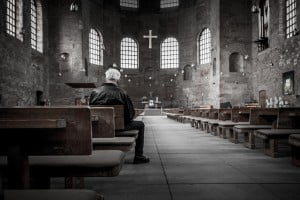 Priest in church