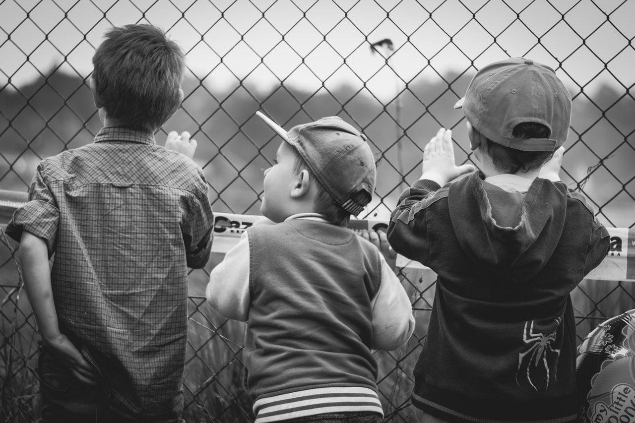 Black and white image of three children