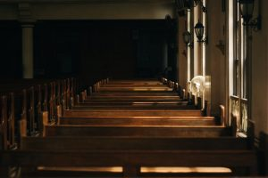 empty wooden church pews with fan