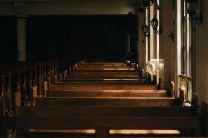 empty wooden church pews with fan