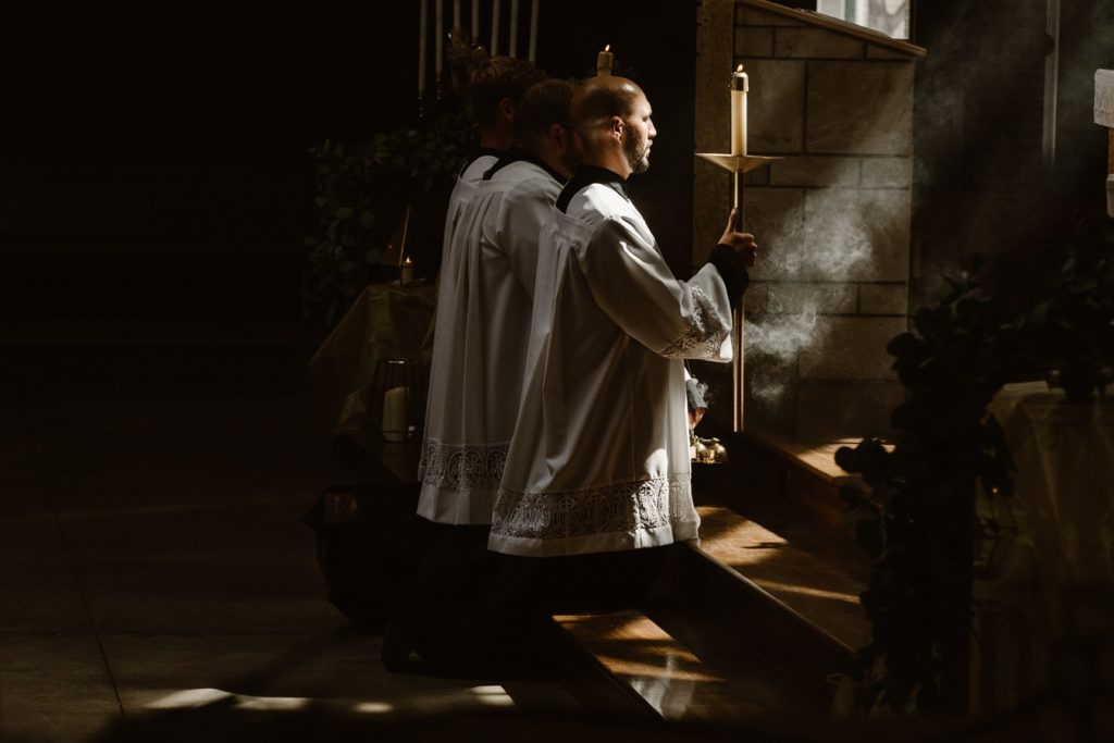 priests kneeling at alter
