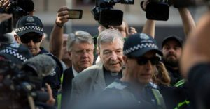 George Pell with police