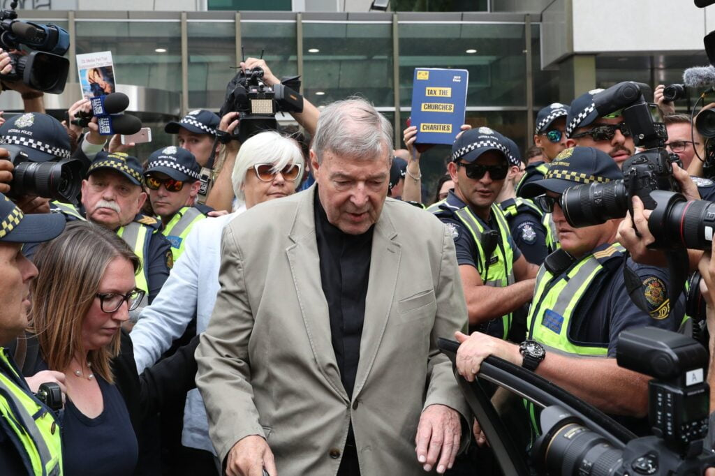 george pell leaving court with police escort