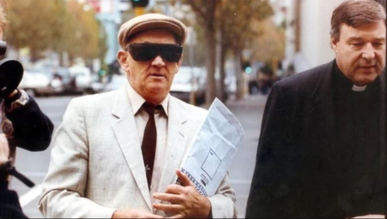 Gerald Ridsdale heading off to court with George Pell