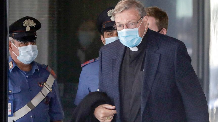 george pell returns to rome in face mask