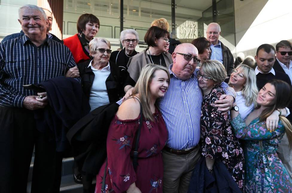 survivor peter creigh hugging family outside court