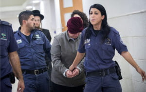 malka leifer being led away by police