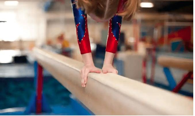 girl on balancing beam