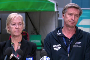 Swimming Australia officials speaking to the media